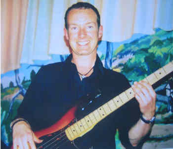 listen to bass playing with Andy Williams bassist with the big blue blues band