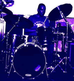 Ben Matthews plays drums with The Big Blue